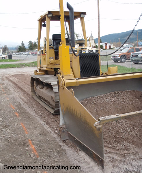 dozer box spreading gravel