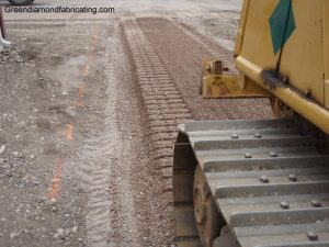 spreading gravel with dozer